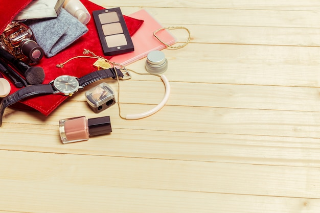 View on women bag stuff on wooden surface