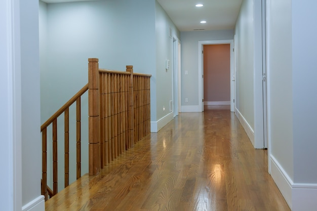 View of wooden glossy stairs from upword showing a beautiful scenery hunged