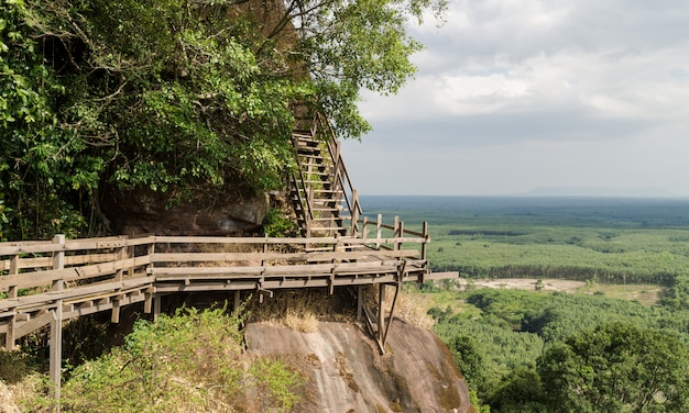 View of a wooden walkway that stretches along the cliffs