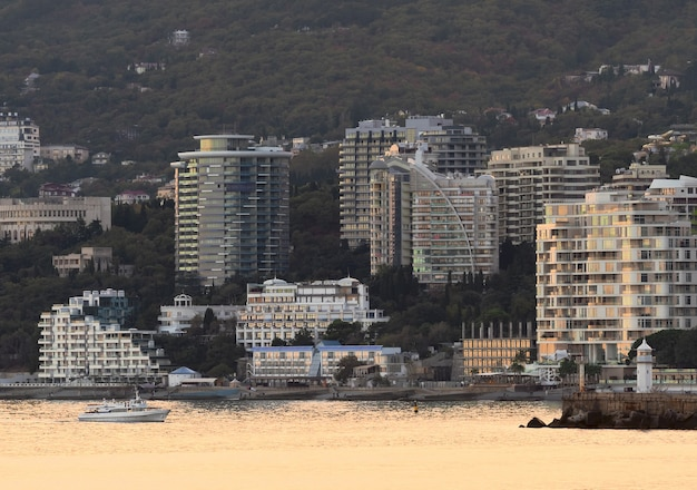 View of yalta from the sea lighthouse hotels holiday homes ship in the evening