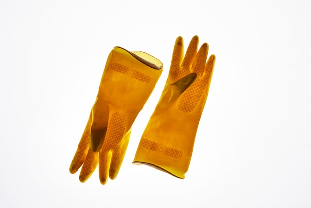 Above view at yellow rubber gloves isolated, waste sorting and management concept