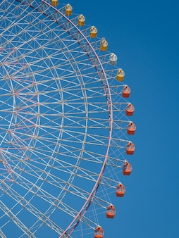 Viewing of giant ferris wheel against the blue sky