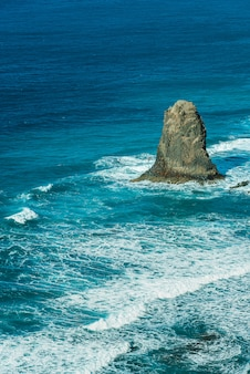 Viewpoint on famous benijo rock with ocean waves crushing located at benijo beach seen from above, tenerife, spain.