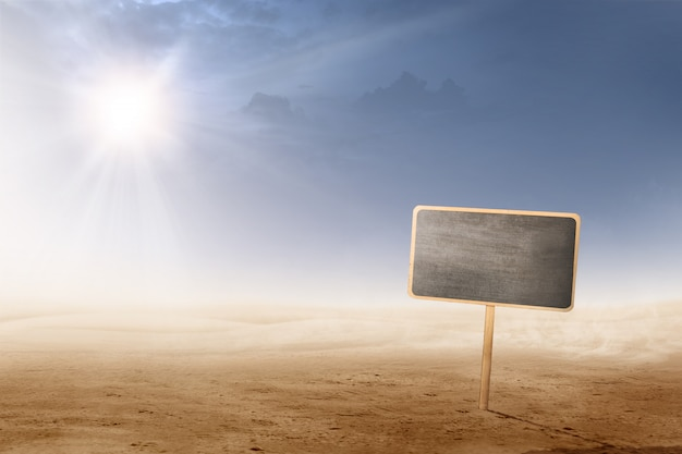 Views of desert with sunlight and little blackboard plank for copyspace