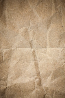 Vignette brown crumpled paper.