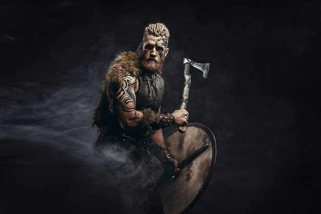 Viking dressed in the skin of a bear attacking an ax
