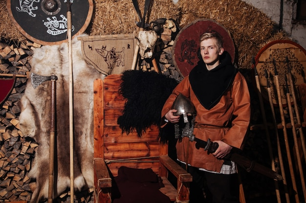 Viking posing against the ancient interior of the vikings.