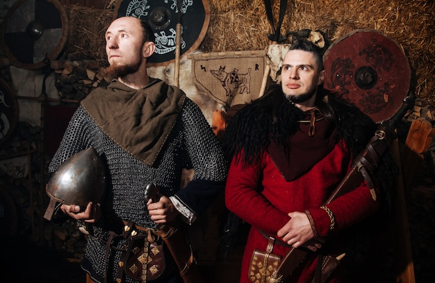Vikings posing against the ancient interior of the vikings.