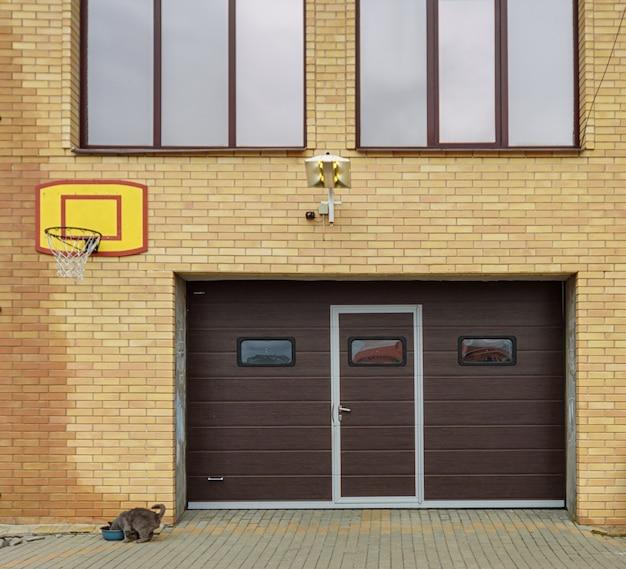 Village house. view of the garage door.