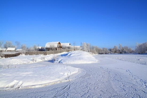 Village near freeze river