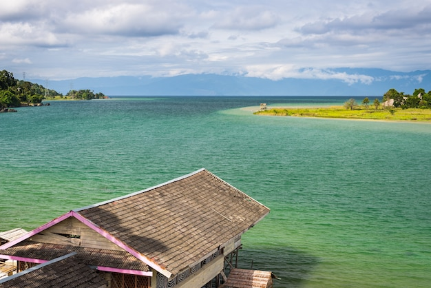 Village and stilt huts at tentena on lake poso in central sulawesi, indonesia