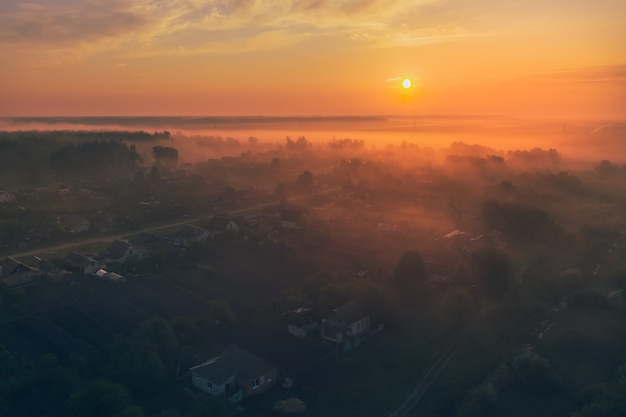 Village at sunrise with fog in the early morning