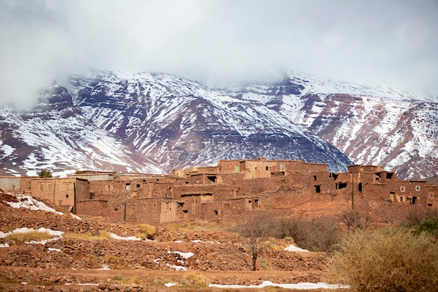 Village with snowcovered atlas mountains in the back in morocco