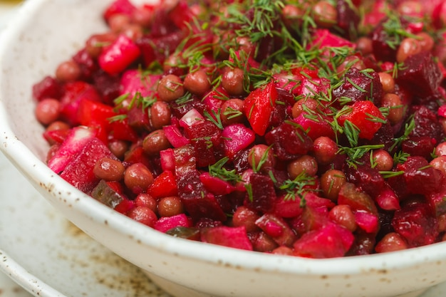 Vinaigrette is a traditional russian and ukrainian vegetable salad of beets, carrots, potatoes, pickles, green peas and dill, vegetarian diet dish