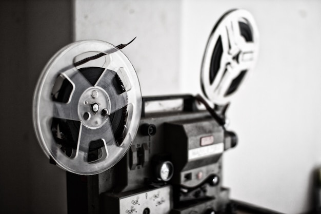 Vintage 8mm projector spools in dark room