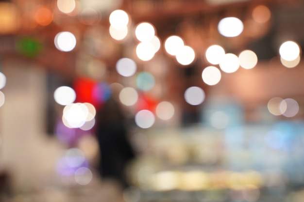 Vintage abstract blurred image of cafe's hallway with bokeh
