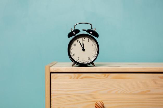 Vintage alarm clock on  bedside table