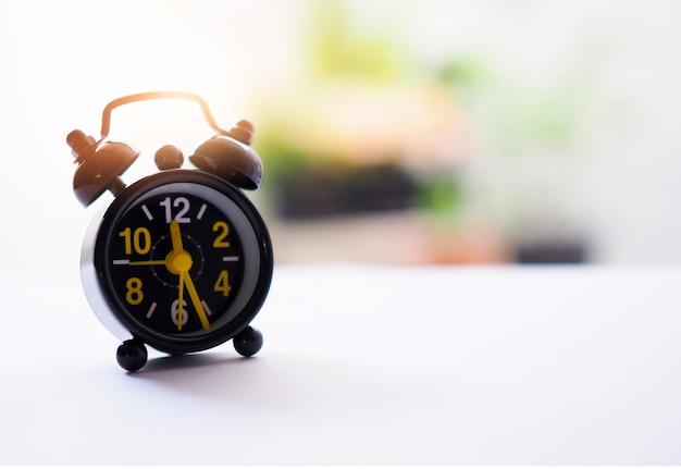 Vintage alarm clock on the desk.