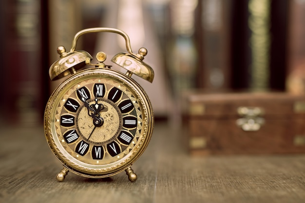 Vintage alarm clock showing five to twelve. happy new year 2015!