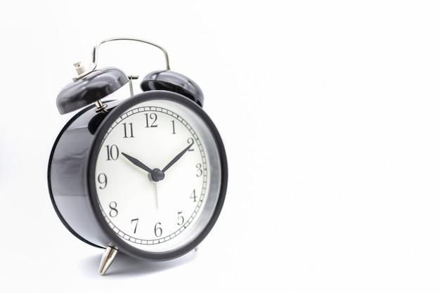 Vintage alarm clock on white.