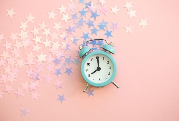 Vintage alarm clock  with star shiny confetti