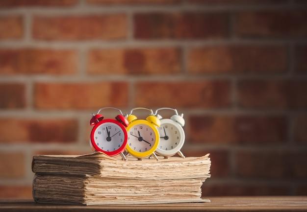Vintage alarm clocks and old books