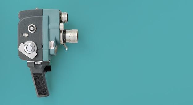 Vintage analog camera on blue background