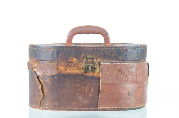 The vintage antique bag isolated over white background