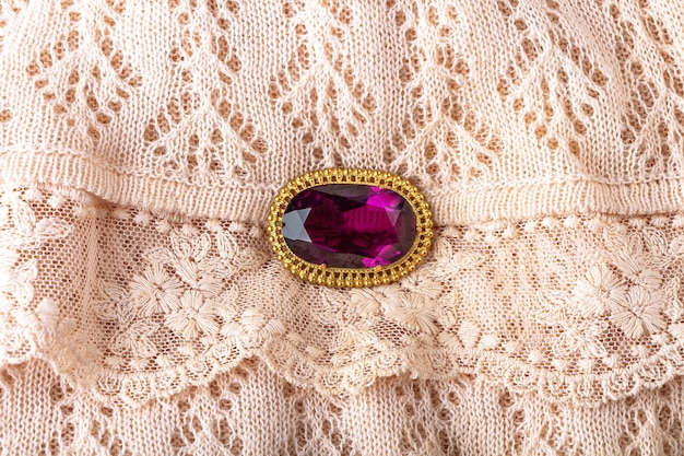 Vintage antique brooch with a large semi-precious purple stone