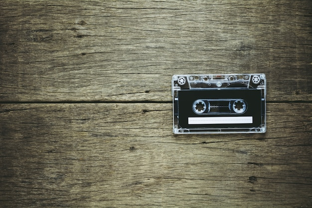 Vintage audio cassette tapes on wooden background.