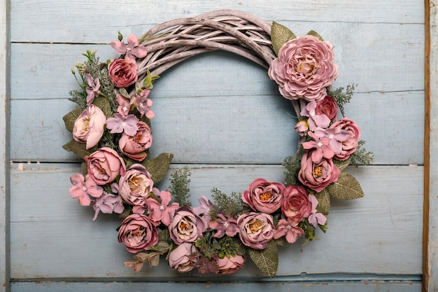 Vintage autumn wreath from leaves and flowers on shabbi wood