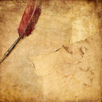Vintage background with a pen and writing