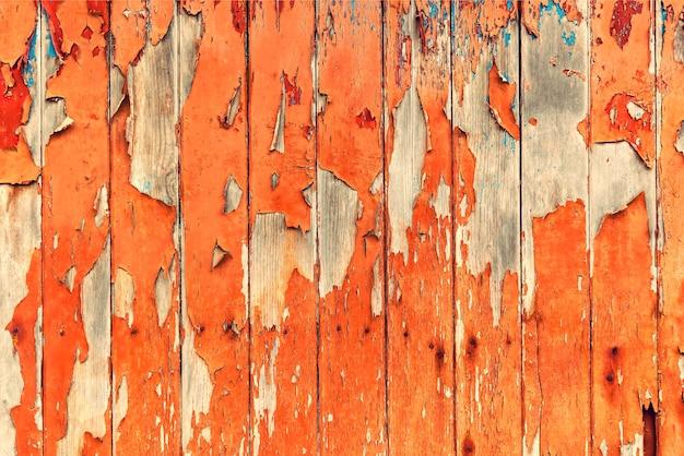 デザインと創造性のためのヴィンテージの背景の木の質感は、パンフレットや壁紙のカバーとして使用できます。欠けたペイント、木製の質感の古い木の板