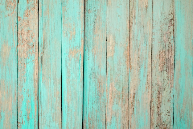 Vintage beach wood - old weathered wooden plank painted in turquoise blue pastel color.