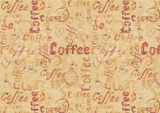レタリング、ハート、コーヒーカップ、カップの痕跡とヴィンテージベージュの古い紙のコーヒーの表面