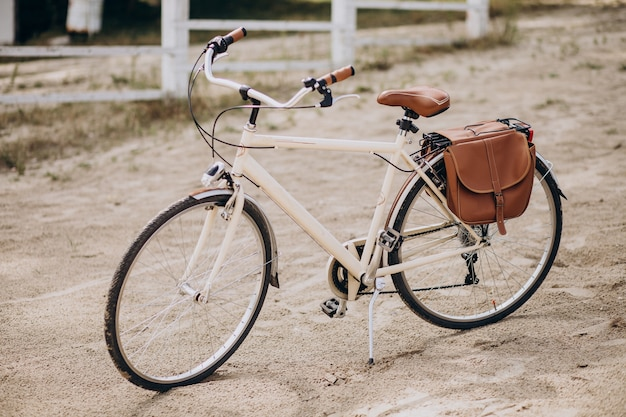 Vintage bicycle alone standing on sand