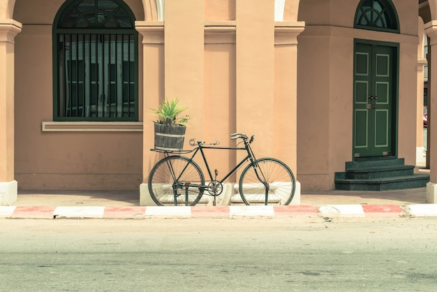 Vintage bicycle on wall background