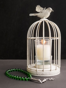 Vintage birdcage candle holder with islamic prayer beads