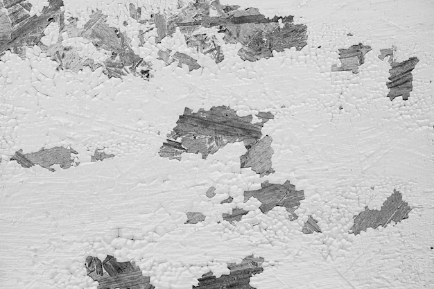 傷のあるヴィンテージの黒と白の壁