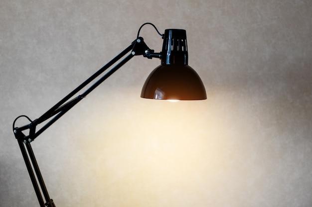Vintage black reading table lamp turn on in room