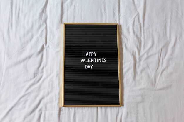 Vintage blackboard with happy valentines day message over with background. home, indoors. concept