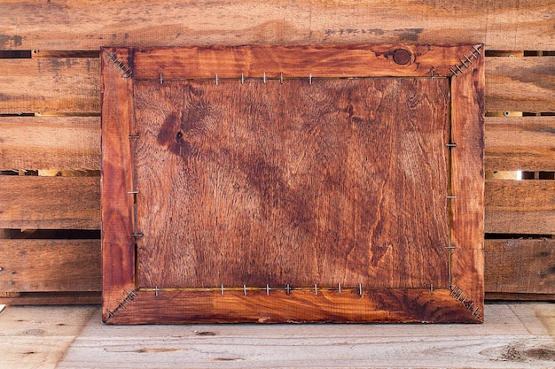 Vintage blank photo on wooden table