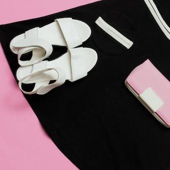 Vintage boutique for ladies. retro summer. sandals outfit and black dress. clutch. minimal design