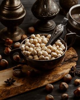 A vintage bowl of roasted hazelnut