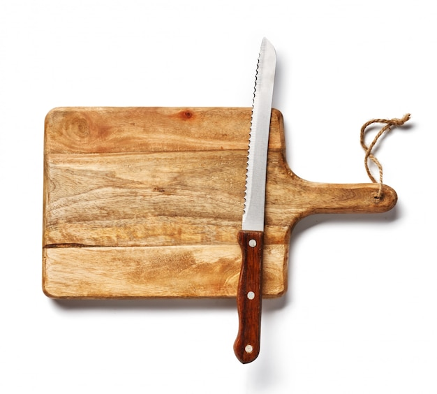 Vintage bread knife on wooden board isolated