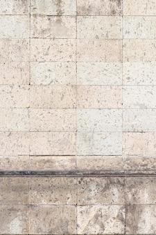 都市の建物の壁のヴィンテージレンガ