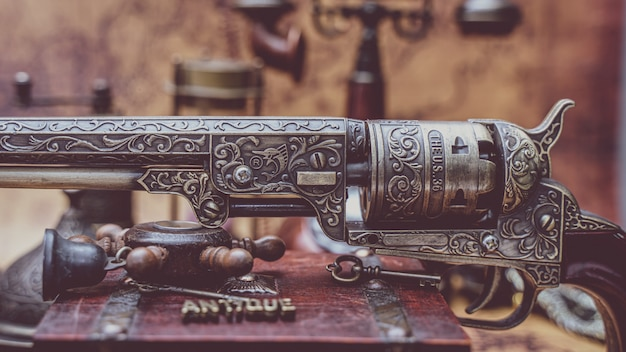 Vintage bronze carved gun collectible