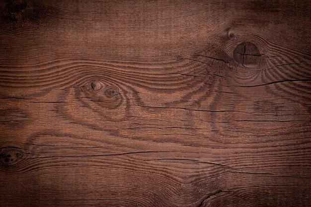 매듭이 있는 빈티지 갈색 나무 배경 텍스처