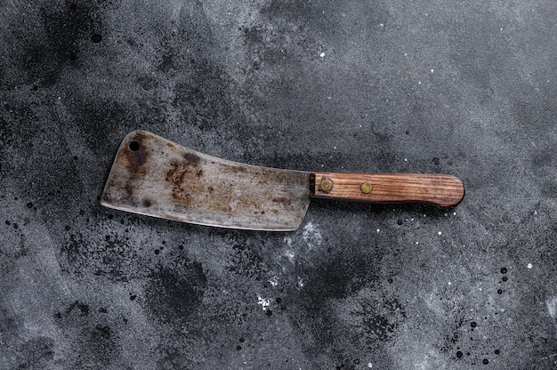 Vintage butcher cleaver with wooden handle. black background