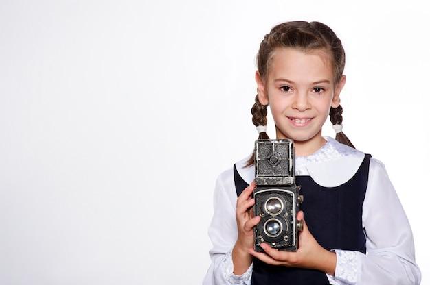 Vintage camera in hand of yang european girl.